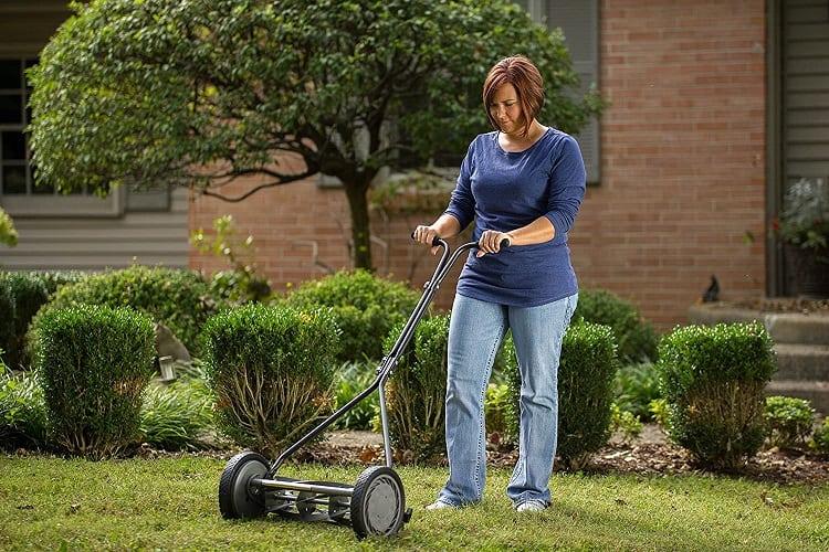 Woman Using Reel Lawn Mower