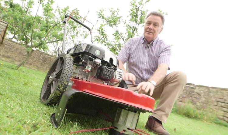 Man Showing Wheeled Grass Trimmer