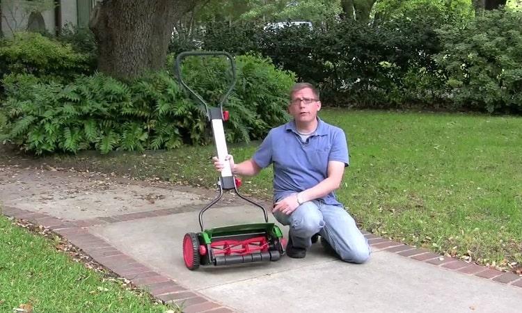 Man Showing Reel Lawn Mower