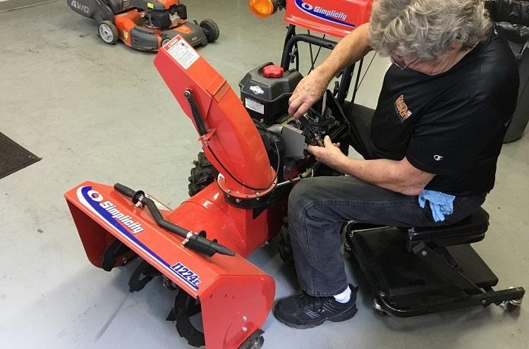 Man Repairing Snow Blower