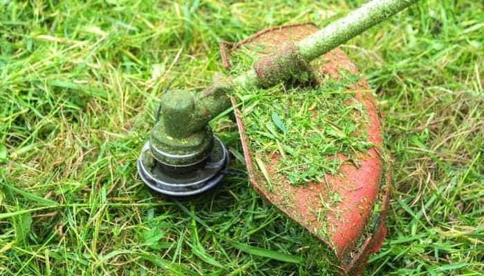 remove lawn mower blade which is holding grass